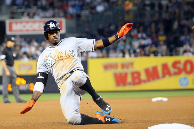 Jun 18, 2015; Bronx, NY, USA; Miami Marlins second baseman Dee Gordon (9) slides to third on his triple to deep right during the fourth inning against the New York Yankees at Yankee Stadium. (Anth ...