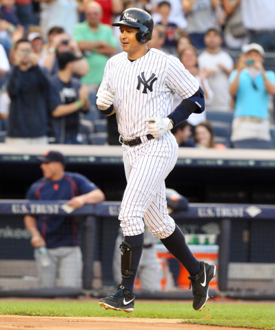 Jun 19, 2015; Bronx, NY, USA; New York Yankees designated hitter Alex Rodriguez (13) rounds the bases after hitting a solo home run against the Detroit Tigers during the first inning at Yankee Sta ...