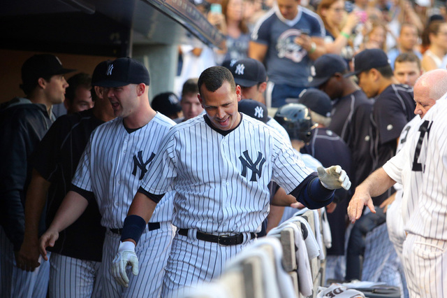 Jun 19, 2015; Bronx, NY, USA; New York Yankees designated hitter Alex Rodriguez (13) in the dugout after hitting a solo home run against the Detroit Tigers during the first inning at Yankee Stadiu ...