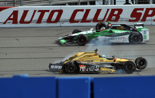 The car of IndyCar driver Ryan Briscoe (5) comes to rest after a crash during the MAVTV 500 at Auto Club Speedway in Fontana, Calif., on June 27, 2015. (Gary A. Vasquez-USA TODAY Sports)