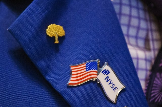 Pins are displayed on a trader's jacket as he works on the floor of the New York Stock Exchange, New York, June 16, 2015.( REUTERS/Lucas Jackson)