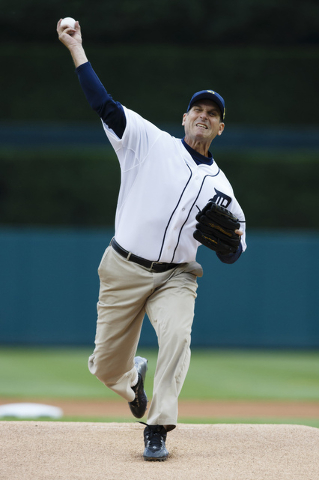 Jun 30, 2015; Detroit, MI, USA; Michigan Wolverines head coach Jim Harbaugh throws out the ceremonial first pitch before the game between the Detroit Tigers and the Pittsburgh Pirates at Comerica  ...
