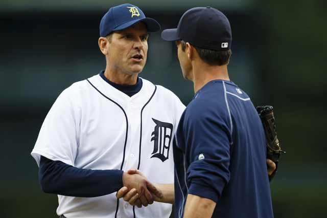 Jun 30, 2015; Detroit, MI, USA; Michigan Wolverines head coach Jim Harbaugh shakes hands with Detroit Tigers manager Brad Ausmus (7) after he throws out the ceremonial first pitch before the game  ...