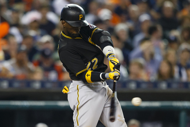 Jun 30, 2015; Detroit, MI, USA; Pittsburgh Pirates center fielder Andrew McCutchen (22) hits an RBI single in the eighth inning against the Detroit Tigers at Comerica Park. (Rick Osentoski-USA TOD ...