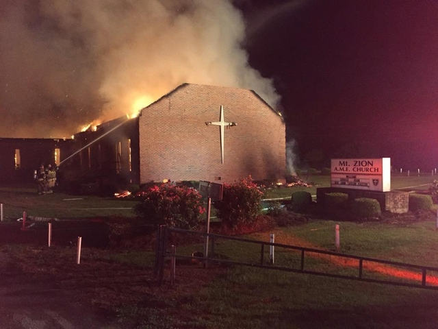 Fire crews try to control a blaze at the Mount Zion African Methodist Episcopal Church in Greeleyville, South Carolina, June 30, 2015. (Reuters/Clarendon County Fire Department/Handout)