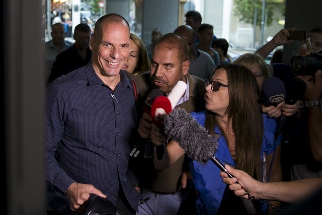 Greek Finance Minister Yanis Varoufakis is surrounded by the media as he leaves the Finance Ministry building in Athens, Greece, July 1, 2015. A defiant Prime Minister Alexis Tsipras urged Greeks  ...