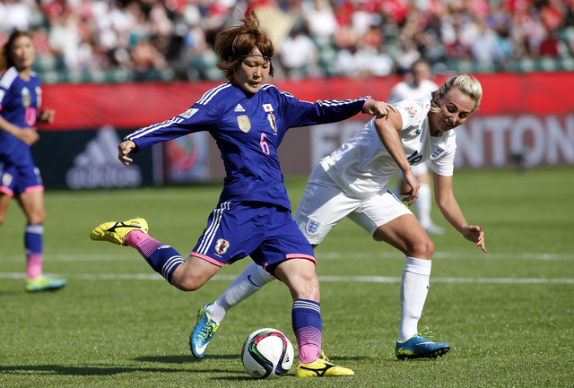 Jul 1, 2015; Edmonton, Alberta, CAN; Japan midfielder Mizuho Sakaguchi (6) and England forward Toni Duggan (18) fight for the ball during the first half in the semifinals of the FIFA 2015 Women's  ...