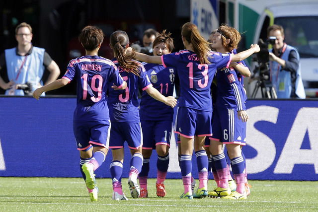 Jul 1, 2015; Edmonton, Alberta, CAN; Japan celebrates after a goal by midfielder Aya Miyama (8) during the first half against the England in the semifinals of the FIFA 2015 Women's World Cup at Co ...