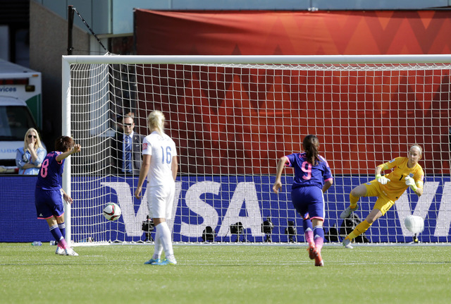 Jul 1, 2015; Edmonton, Alberta, CAN; Japan midfielder Aya Miyama (8) scores a goal on a penalty kick against the England during the first half in the semifinals of the FIFA 2015 Women's World Cup  ...