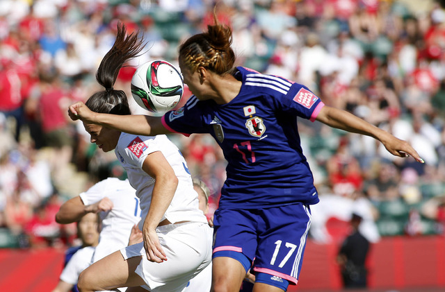 Jul 1, 2015; Edmonton, Alberta, CAN; England defender Claire Rafferty (3) and Japan forward Yuki Ogimi (17) for a header the box during the second half in the semifinals of the FIFA 2015 Women's W ...