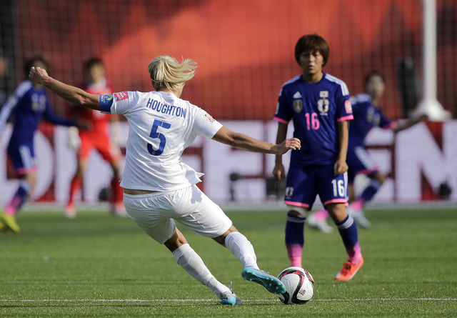 Jul 1, 2015; Edmonton, Alberta, CAN; England defender Steph Houghton (5) plays a free kick against Japan forward Mana Iwabuchi (16) during the second half in the semifinals of the FIFA 2015 Women' ...
