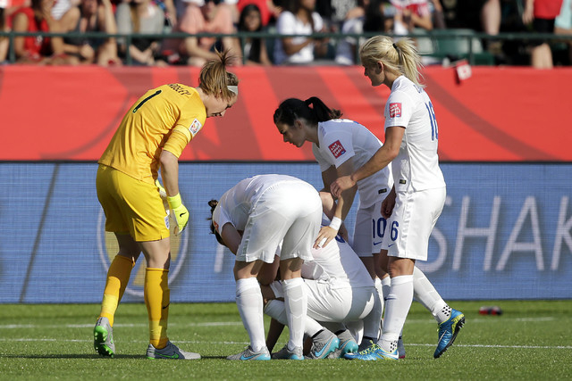 Jul 1, 2015; Edmonton, Alberta, CAN; England reacts with England defender Laura Bassett (6) after she scored an own goal during the second half against Japan in the semifinals of the FIFA 2015 Wom ...