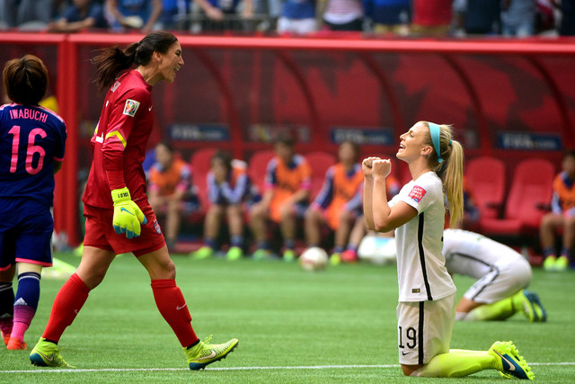 Jul 5, 2015; Vancouver, British Columbia, CAN; United States goalkeeper Hope Solo (1) and United States defender Julie Johnston (19) react after defeating Japan in the second half of the final of  ...