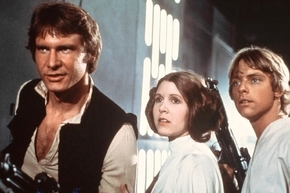 This publicity film image provided by 20th Century-Fox Film Corporation shows, from left, Harrison Ford as Han Solo, Carrie Fisher as Princess Leia Organa and Mark Hamill as Luke Skywalker in a sc ...