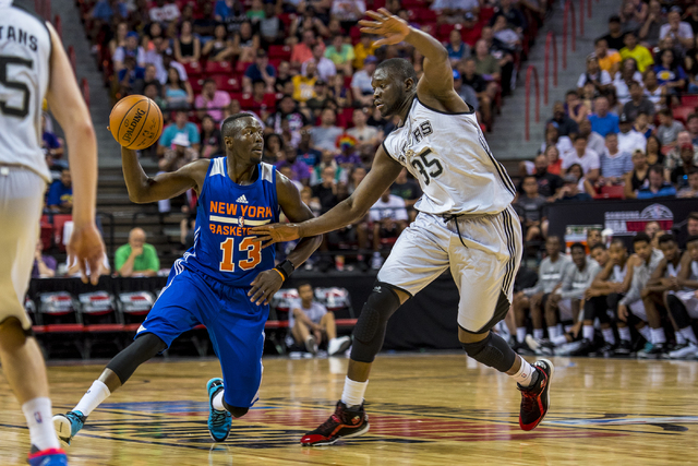 Jerian Grant, (13) of the New York Knicks, looks to get past Youssou Ndoye, (35) of the San Antonio Spurs, during the NBA Summer League at the Thomas & Mack Center in Las Vegas on Saturday, July 1 ...