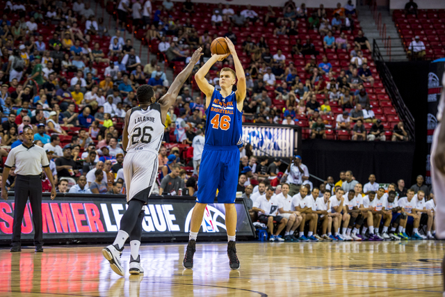 Kristaps Porzingis, (46) of the New York Knicks, takes a shot against Cady Lalanne, (26) of the San Antonio Spurs, during the NBA Summer League at the Thomas & Mack Center in Las Vegas on Saturday ...