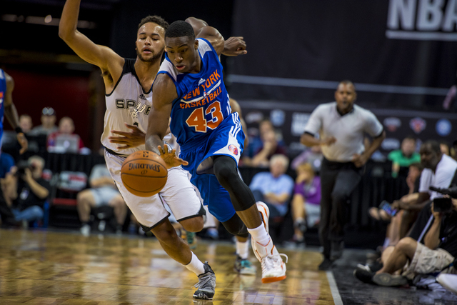 Thanasis Antetokounm, (43) drives past Kyle Anderson, (1) of the San Antonio Spurs, during the NBA Summer League at the Thomas & Mack Center in Las Vegas on Saturday, July 11, 2015. (Joshua Dahl/L ...