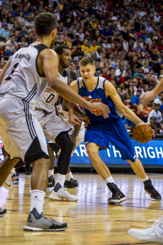 Kristaps Porzingis, (46) drives to the net against Brandon Davies, (0) of the San Antonio Spurs, during the NBA Summer League at the Thomas & Mack Center in Las Vegas on Saturday, July 11, 2015. ( ...