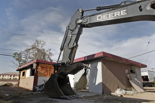An excavator is seen next to a blighted house on 108 E. Tonopah Ave. on Wednesday, July 1, 2015, in North Las Vegas. The city of North Las Vegas aims to tear down other homes in similar conditions ...