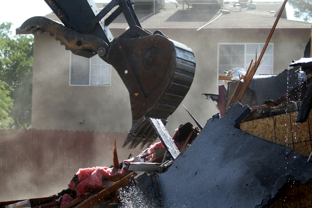 A blighted house on 108 E. Tonopah Ave. is torn down on Wednesday, July 1, 2015, in North Las Vegas. (James Tensuan/Las Vegas-Review Journal) Follow @jtensuan on Twitter.