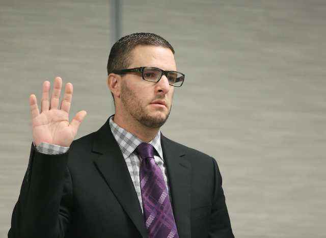 Suspended defense lawyer Brian Bloomfield is sworn in as he appears in front of a State Bar of Nevada disciplinary panel Friday, June 19, 2015, in Las Vegas. Bloomfield pleaded guilty to four crim ...