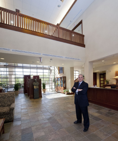 Realtor Sam Gladstein stands in the lobby of the Donald W. Reynolds Foundation.  (Jerry Henkel/Las Vegas Review-Journal)