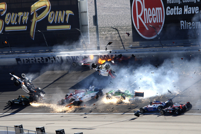 Jessica Ebelhar's photo of the Dan Wheldon Indy car crash won First Place News Photo in the  2011 Better Newspapers Contest, sponsored by the California Newspaper Publishers Association.  ___The f ...