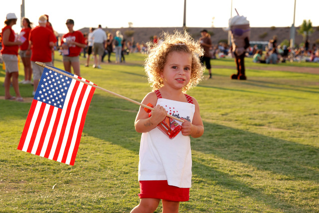 A child holds a flag while attending the annual Fourth of July Celebration at Mission Hills Park, 551 E. Mission Hills Drive. This year's event is planned from 6 to 9 p.m. July 4 and is set to inc ...