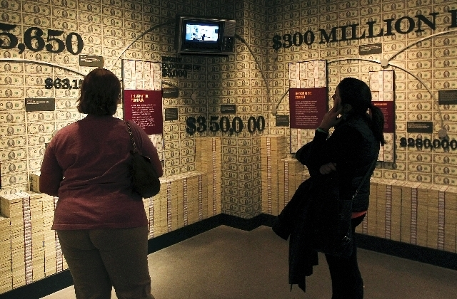 """Visitors to the Mob Museum look at a display last year at the facility, 300 E. Stewart Ave. As part of the Speakeasy Cinema Classic Mob Noir Series, a screening of the 1950 film """"Dark City"""" is ..."""