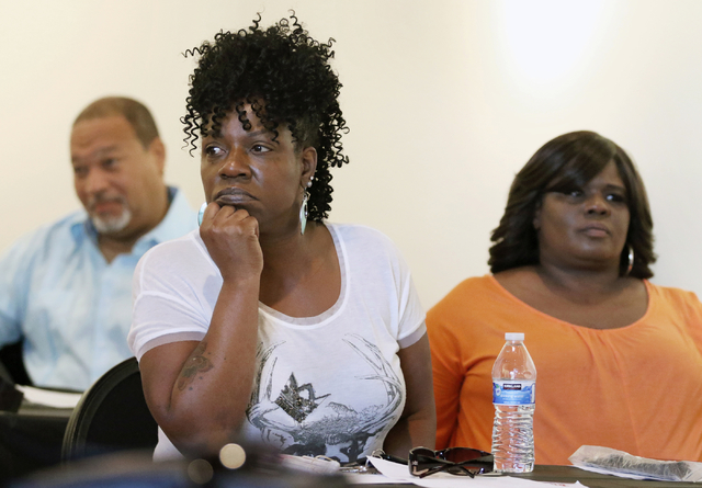 Yolanda Dyess, front left, and Stephanie Shelby, right, attend a town hall meeting hosted by the Sheriff African-American Advisory Council at West Las Vegas Arts Center Saturday, June 27, 2015, in ...