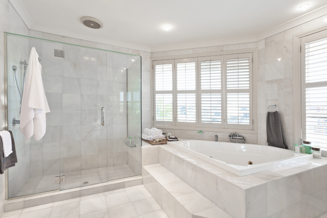 Thinkstock In-glass hooks can be used to hang a robe or a towel on the glass shower enclosure.