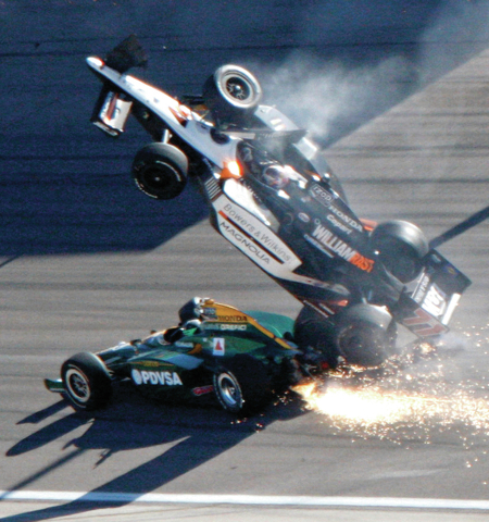 Dan Wheldon (77) goes airborne during a wreck that involved 15 cars in the IndyCar Series' Las Vegas Indy 300 auto race at Las Vegas Motor Speedway in Las Vegas on Sunday, Oct. 16, 2011. Wheldon d ...