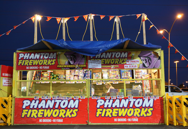 A Phantom Fireworks stand is open for business at the northeast corner of Flamingo Road and Rainbow Boulevard Tuesday, June 30, 2015, in Las Vegas. Volunteers worked at the 24-hour stand for WestC ...