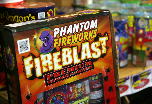 Fireworks are shown inside a Phantom Fireworks stand at the northeast corner of Flamingo Road and Rainbow Boulevard Tuesday, June 30, 2015, in Las Vegas. Volunteers worked at the 24-hour stand for ...