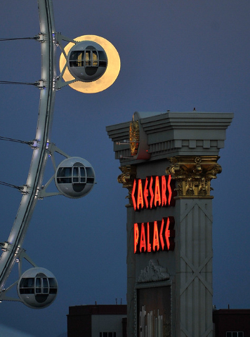 A nearly full moon rises behind the Las Vegas High Roller at The LINQ on Monday, April 14, 2015. (David Becker/Las Vegas Review-Journal)