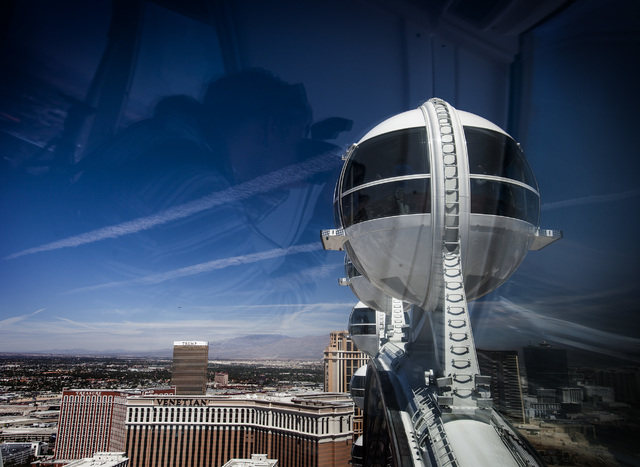 A reflection of a man taking a photo as seen  Monday, March 31, 2014 while riding the High Roller at The Linq. The world's tallest observation wheel opened to the public today.(Jeff Scheid/Las Veg ...