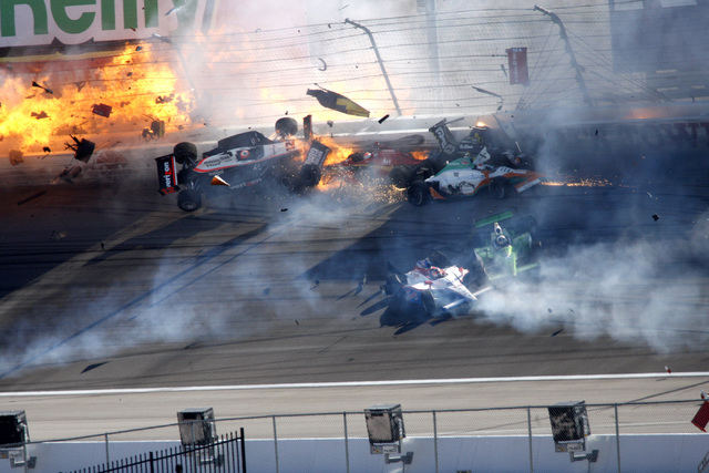 RJ FILE*** JESSICA EBELHAR/LAS VEGAS REVIEW-JOURNAL IndyCar race cars come apart as they spin, bump, crash and fly through the air as a tightly packed group of racers disintegrate into a 15-car pi ...