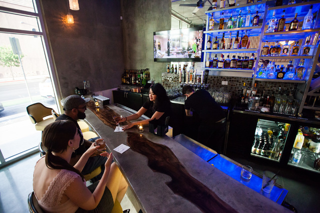 Justine Galutera, right, delivers drinks to to Nicole Ely, left, and Zoneil Maharaj at Classic Jewel, a lounge with a retro Las Vegas theme, at Juhl, 353 E. Bonneville Ave., in downtown Las Vegas  ...