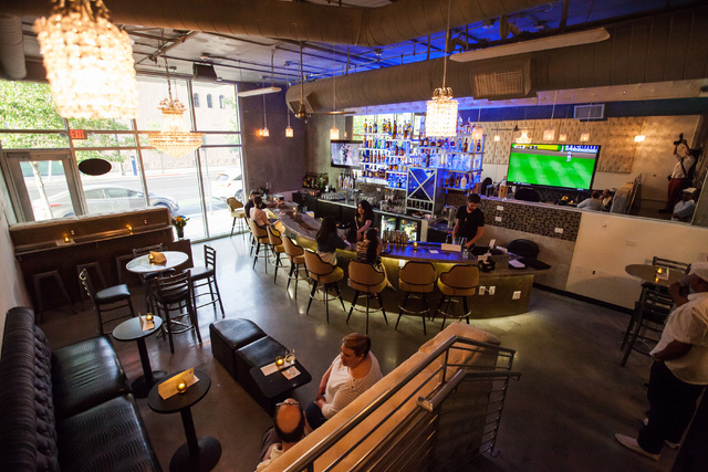 Patrons hang out at at Classic Jewel, a lounge with a retro Las Vegas theme, at Juhl, 353 E. Bonneville Ave., in downtown Las Vegas on Tuesday, June 30, 2015. The lounge is one of multiple busines ...