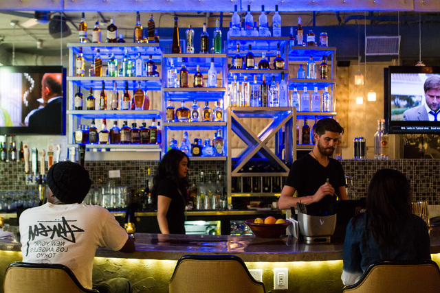 Steven Tankersley, third from left, prepares a drink at Classic Jewel, a lounge with a retro Las Vegas theme, at Juhl, 353 E. Bonneville Ave., in downtown Las Vegas on Tuesday, June 30, 2015. The  ...