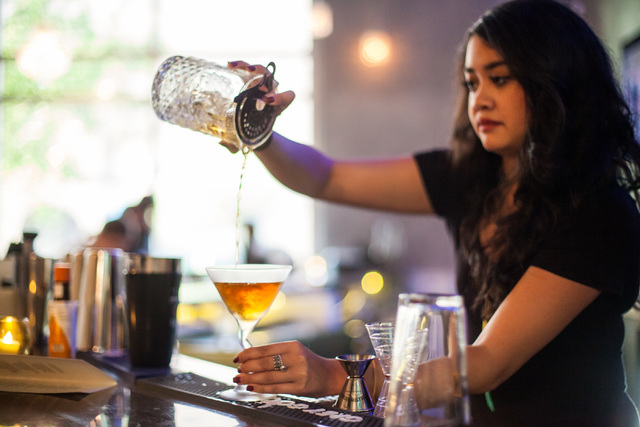 """Justine Galutera makes the """"Brooklyn to Vegas"""" cocktail at Classic Jewel, a lounge with a retro Las Vegas theme, at Juhl, 353 E. Bonneville Ave., in downtown Las Vegas on Tuesday, June 3 ..."""