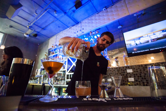 Steven Tankersley makes a drink at Classic Jewel, a lounge with a retro Las Vegas theme, at Juhl, 353 E. Bonneville Ave., in downtown Las Vegas on Tuesday, June 30, 2015. The lounge is one of mult ...
