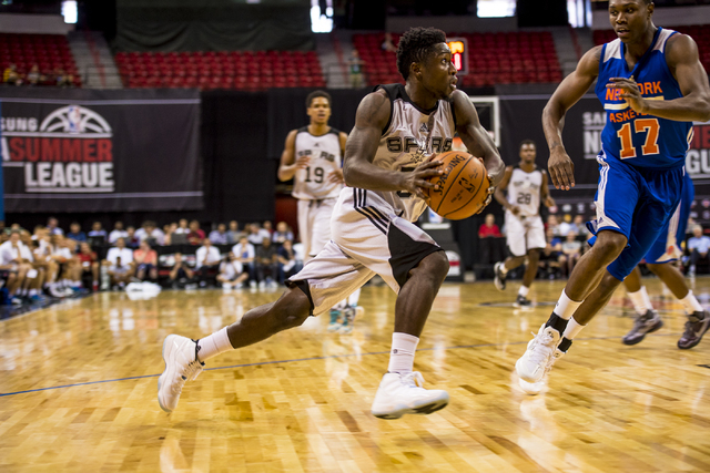 Will Cherry, (56) of the San Antonio Spurs, drives to the net against Cleanthony Early, (17) of the New York Knicks, during the NBA Summer League at the Thomas & Mack Center in Las Vegas on Saturd ...