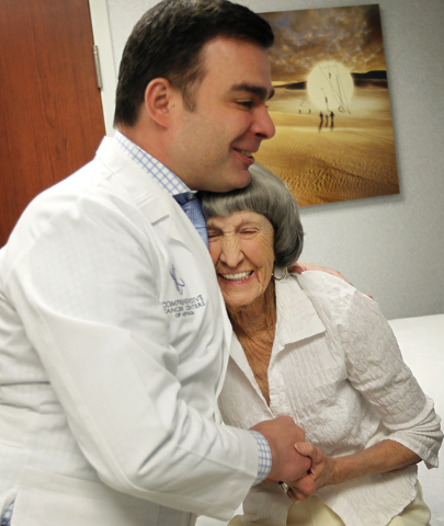 Dr. Fadi Braiteh hugs patient Rosemary Rathbun in this January 2014 photo. Braiteh received nearly $500,000 in payments. (Jason Bean/Las Vegas Review-Journal)