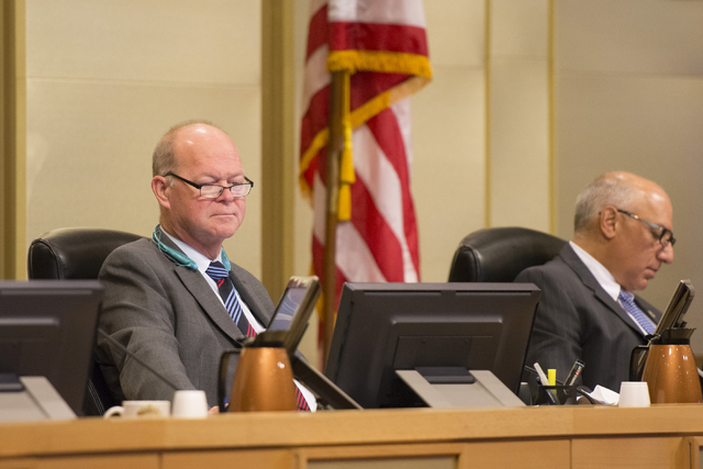 Las Vegas Councilman, Bob Beers, left, listens to Dotty's attorney, Susan Johnson, during a meeting at council chambers in Las Vegas City Hall, Wednesday, July 01, 2015. (Jason Ogulnik/Las Vegas R ...