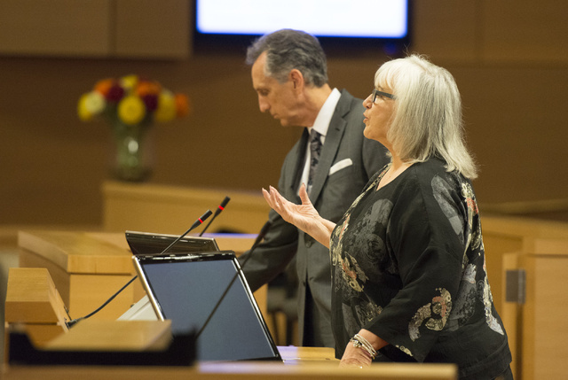 Susan Johnson, attorney for Dotty's, right, speaks to the city council's agency members during a meeting at council chambers in Las Vegas City Hall, Wednesday, July 01, 2015. (Jason Ogulnik/Las Ve ...