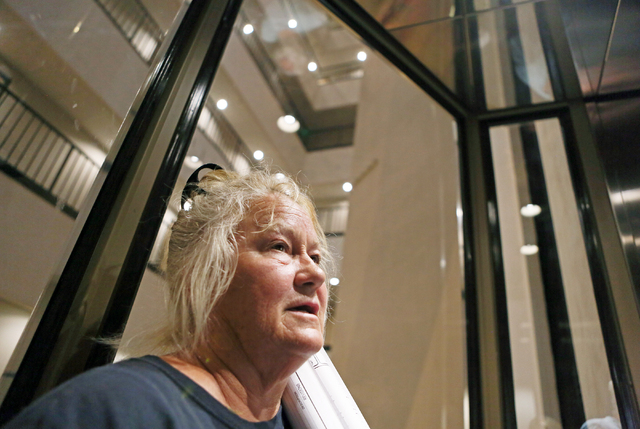 Sharon Linsenbardt, a longtime Clark County resident and owner of an animal shelter in the northwest valley, holds blueprints of her property at Las Vegas City Hall Tuesday, July 1, 2015. (Ronda C ...