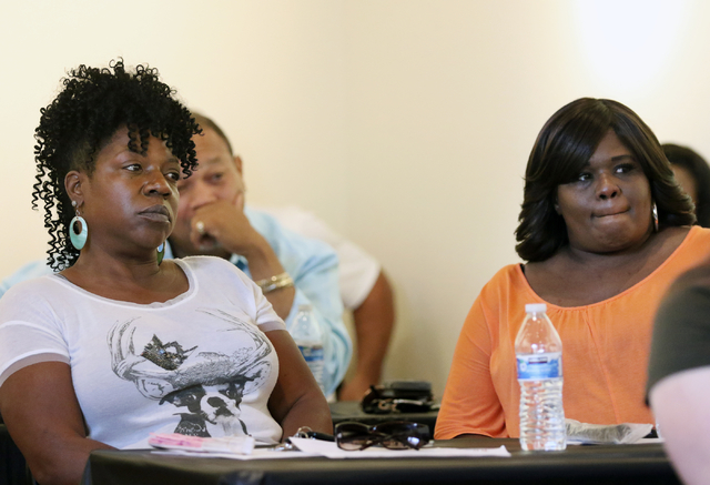 Yolanda Dyess, left, and Stephanie Shelby attend a town hall meeting hosted by the Sheriff African-American Advisory Council at West Las Vegas Arts Center Saturday, June 27, 2015, in Las Vegas. Dy ...
