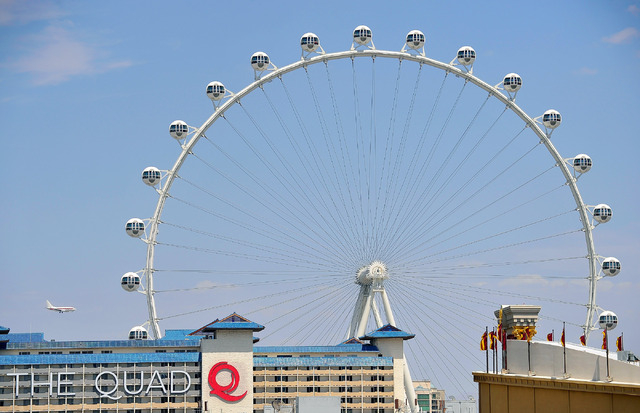 A jetliner flies by the Las Vegas High Roller and The Quad hotel-casino as it prepares to land at McCarran International Airport on Tuesday, June 10, 2014. (David Becker/Las Vegas Review-Journal)