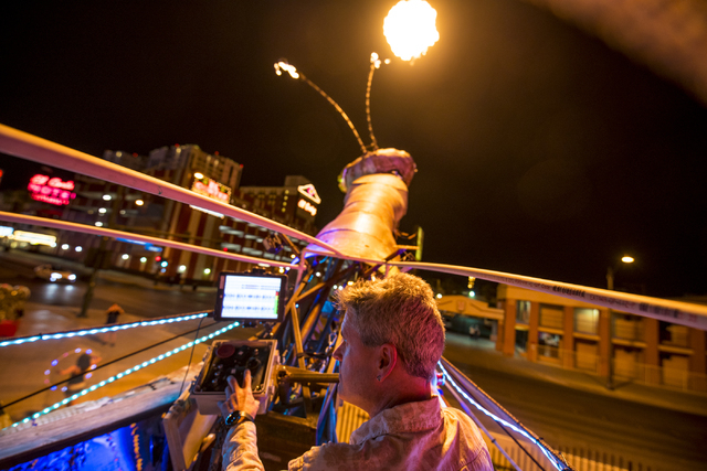 Merritt Pelkey operates the fire-shooting preying mantis that sits out front of Container Park in downtown Las Vegas on Wednesday, July 1, 2015. (Joshua Dahl/Las Vegas Review-Journal)